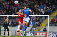 Jim McNulty wins a challenge during the EFL Sky Bet League 1 match between Rochdale and Gillingham at Spotland, Rochdale, England on 23 September 2017. Photo by Daniel Youngs.