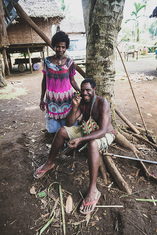 William Assin, his wife Maliya standing beside him, holds betelnut in his right hand in the village of Likan in Papua New Guinea's East Sepik province.<br /> <br /> (Jun 20, 2019)<br /><br />(June 20, 2019)