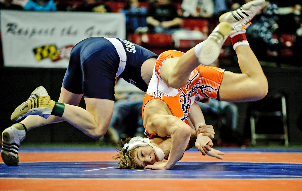 (staff photo by Matt Roth)..Reservoir's  Mark Colabucci maintained his undefeated record by beating La Pata's Connar Zimmerman 5-3, to clench the 3A/4A 145 state championship title. The contest was held at The University of Maryland's Cole Field House Saturday, March 6, 2010.