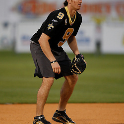 Apr 28, 2010; Metairie, LA, USA; Drew Brees (9) in the field during the Heath Evans Foundation charity softball featuring teammates of the Super Bowl XLIV Champion New Orleans Saints at Zephyrs Field.  Mandatory Credit: Derick E. Hingle-US-PRESSWIRE.
