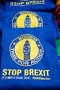 Anti Brexit protesters outside Parliament, Westminster, London as Members of Parliament debate the European Union withdrawal bill, June 20th 2018. Tee shirts on sale with the slogan Stop Brexit.