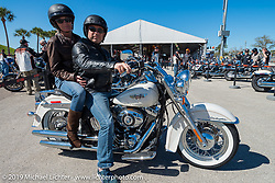 Claudine Poacher and Thierry Legendarme of Paris, France before starting out on their test ride of a 2014 Softail Deluxe during Daytona Bike Week. , FL., USA. March 8, 2014.  Photography ©2014 Michael Lichter.