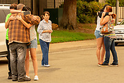 From left: Cindy Lamkin, James Welch, Lisa Shifflet, Katy Silva, Katie Lamkin and Carla Bledsoe grieve outside the Shasta County Sheriff's Department, Saturday, July 28, 2018, in Redding, Calif. Bledsoe's friends came out to support as they found out Bledsoe's niece Emily Roberts, 5, nephew James, 4, and her grandmother Melody Bledsoe, 70, died as they attempted to escape the Carr Fire along Quartz Hill Road.