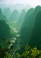 Looking up a valley of limestone karsts from Yangshuo, China in the late afternoon light.