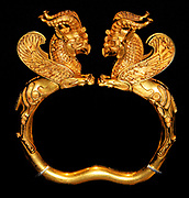 Pair of gold armlets. These objects are among the most important surviving items of ancient Persian craftsmanship. It is likely that they were intended to display rather than being worn. The lion griffin terminals were originally inlaid with precious stones, which were later removed.5th-4th century BC