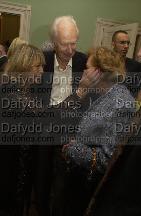 Cynthia Lennon, Sir George Martin, Lady Martin, Launch of 'John' by Cynthia Lennon at Six, Fitzroy Sq. London. 27 September 2005. ONE TIME USE ONLY - DO NOT ARCHIVE © Copyright Photograph by Dafydd Jones 66 Stockwell Park Rd. London SW9 0DA Tel 020 7733 0108 www.dafjones.com