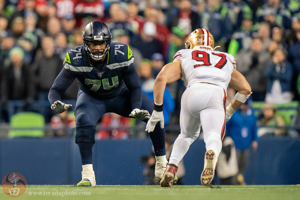 December 29, 2019; Seattle, Washington, USA; Seattle Seahawks offensive tackle George Fant (74) against San Francisco 49ers defensive end Nick Bosa (97) during the fourth quarter at CenturyLink Field.