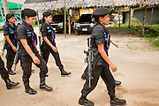 Sept. 29, 2009 -- BAAN TROKBON, THAILAND: Thai women Rangers leave their base on patrol. The 39 women in the 44th Army Ranger Regiment are the only Thai women seeing front line active duty against Moslem insurgents in Thailand's deep south provinces of Pattani, Narathiwat and Yala. All of the other women serving in Thai security services are employed as office and clerical workers. The Ranger women are based at the Ranger camp in the Buddhist village of Baan Trokbon in Sai Buri district of Pattani province. The unit was formed in 2006 after Muslims complained about the way Thai soldiers, all men, treated Muslim women at roadblocks and during security sweeps. The women are frequently called upon to back up Thai regular army units when they are expected to encounter a large number of Muslim women. At least two of the women have been killed by Muslim insurgents. The unit has both Muslim and Buddhist members. Many of the women in the unit joined after either their fathers or husbands were killed by insurgents.    Photo by Jack Kurtz / ZUMA Press