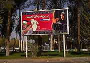 IRAN vs USA Love and Hate<br /> <br /> The United States and Iran have resumed their talks on a nuclear deal and the lifting of the embargo. But in the streets of Iran, there is still a lot of propaganda against the Americans, showing Obama as a traitor and U.S. Marines as murderers. At the same time, Iranian people increasingly appear to be adopting an American way of life, using iPhones, eating in fake KFCs, drinking Pepsi, and wearing Nike shoes.<br /> <br /> PHOTO SHOWS:  In the neighborhood of Yazd, this billboard blasts the USA for not respecting human rights. It depicts Obama as Yazid, who was responsible for the death of shia Imam Hussein. A man is holding a Palestinian baby. The arrowhead aimed at them bears the Israeli Star David. The Great Satan and the Little Satan (Israel) are shown as baby killers.<br /> ©eric lafforgue/Exclusivepix Media