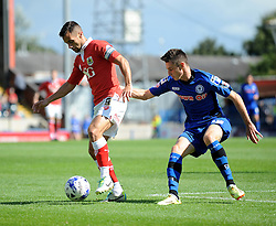 Bristol City's Sam Baldock holds up the ball from Rochdale's Scott Tanser - Photo mandatory by-line: Dougie Allward/JMP - Mobile: 07966 386802 23/08/2014 - SPORT - FOOTBALL - Manchester - Spotland Stadium - Rochdale AFC v Bristol City - Sky Bet League One