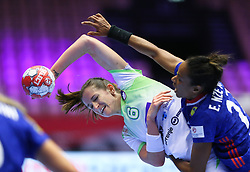 HERNING, DENMARK - DECEMBER 6: Ana Gros is tackled by Estelle Nze Minko during the EHF Euro 2020 Group A match between Slovenia and France in Jyske Bank Boxen, Herning, Denmark on December 6, 2020. Photo Credit: Allan Jensen/EVENTMEDIA.