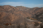 Wildfire damage along Kanan Dume Road. The Woolsey wildfire started on November 8, 2018 and has burned over 98,000 acres of land, destroyed an estimated 1,100 structures and killed 3 people in Los Angeles and Ventura counties and the especially hard hit area of Malibu. California, USA