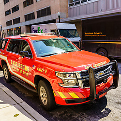 Harrisburg, PA / USA - May 15, 2020: The Harrisburg Fire Department's Chief's car, parked along a city street.