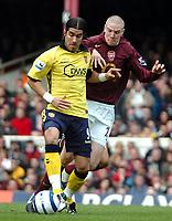 Photo: Ed Godden.<br />Arsenal v Aston Villa. The Barclays Premiership. 01/04/2006. Juan Pablo Angel (L) and Arsenal's, Philippe Senderos (R)
