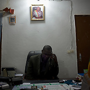 January 19, 2013 - Niono, Mali: Moriba Coulibaly, the Major of Niono village, receives a call from people sieged in the neighbouring cry of Diabaly. Niono is the last government controlled location before Diabaly, a city under islamist militants control since the 14th of January. In the back<br /> <br /> Several insurgent groups have been fighting a campaign against the Malian government for independence or greater autonomy for northern Mali, an area known as Azawad. The National Movement for the Liberation of Azawad (MNLA), an organisation fighting to make Azawad an independent homeland for the Tuareg people, had taken control of the region by April 2012.<br /> <br /> The Malian government pledge to the French army to help the national troops to stop the rebellion advance towards the capital Bamako. The french troops started aerial attacks on rebel positions in the centre of the country and deployed several hundred special forces men to counter attack the advance on the ground. (Paulo Nunes dos Santos)