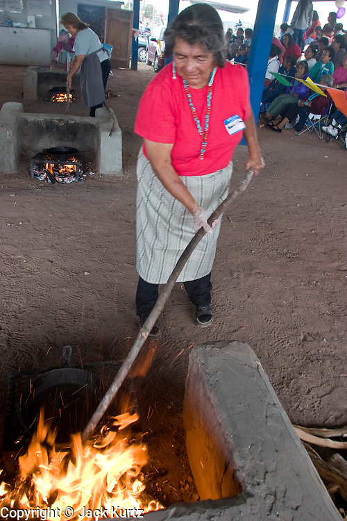 09 SEPTEMBER 2004 - WINDOW ROCK, AZ: A Navajo women make fry bread at the fry bread contest during the 58th annual Navajo Nation Fair in Window Rock, AZ. The Navajo Nation Fair is the largest annual event in Window Rock, the capitol of the Navajo Nation, the largest Indian reservation in the US. The Navajo Nation Fair is one of the largest Native American events in the United States and features traditional Navajo events, like fry bread making contests, pow-wows and an all Indian rodeo.  PHOTO BY JACK KURTZ