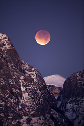 """Moon eclipse over Death Canyon in Grand Teton National Park.<br /> <br /> For production prints or stock photos click the Purchase Print/License Photo Button in upper Right; for Fine Art """"Custom Prints"""" contact Daryl - 208-709-3250 or dh@greater-yellowstone.com"""