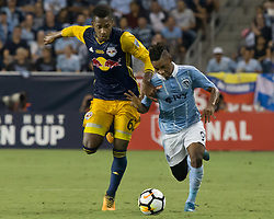 September 20, 2017 - Kansas City, Kansas, U.S - Sequence 01-01: Sporting KC forward Latif Blessing #9 (r) fights off the grip of NY Red Bulls defender Michael Amir Murillo #62 (l) during the first half of the game. Sporting KC will win the 2017 Lamar Hunt Open Cup championship with a score of 2-1 over the New York Red Bulls. (Credit Image: © Serena S.Y. Hsu via ZUMA Wire)