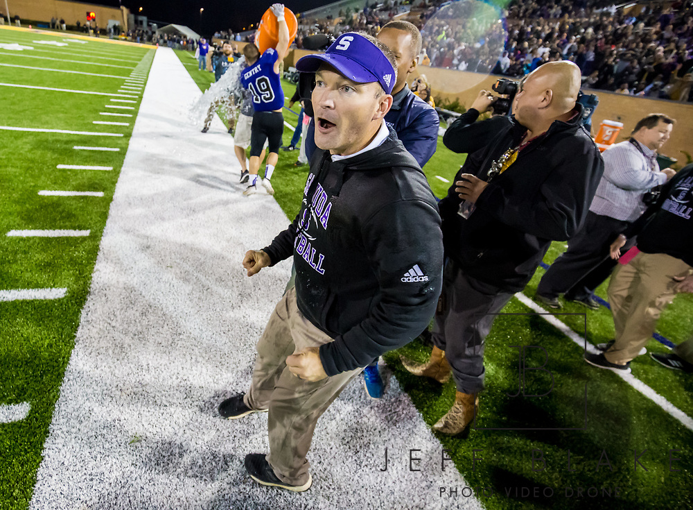 Saluda Tigers head coach Stewart Young celebrates after his team won the Class AA State Championship game against the Barnwell Warhorses. 2019 Saluda State Championship Football Photos