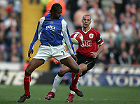 Photo: Lee Earle.<br /> Portsmouth v Manchester United. The Barclays Premiership. 07/04/2007.Portsmouth's Kanu (L) is tracked by United's Rio Ferdinand.