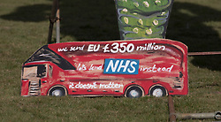 © Licensed to London News Pictures. 31/10/2018. Edenbridge, UK.  EU referendum buses are seen at the feet of an effigy of former foreign secretary Boris Johnson as it is unveiled in Edenbridge, Kent ahead of its burning at the town's bonfire this Saturday. The 10 meter high figure stands over two EU referendum buses and Boris is also carrying an EU cake. Photo credit: Peter Macdiarmid/LNP