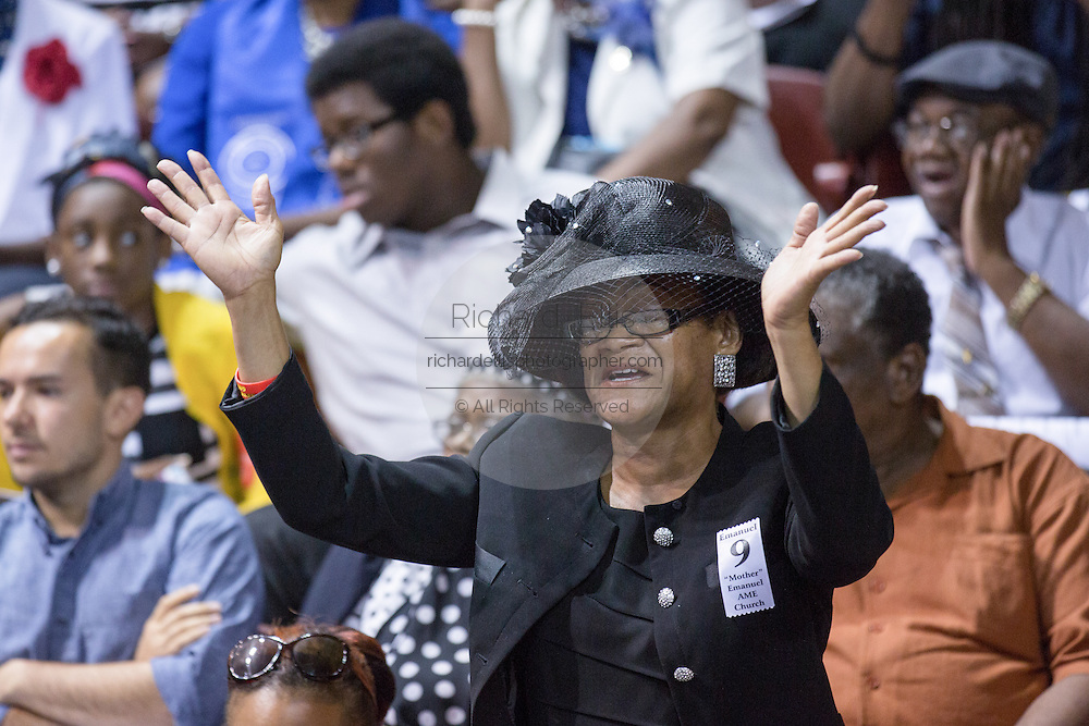 A mourner stands for a hymn during the funeral of slain State Senator Clementa Pinckney at the TD Arena June 24, 2015 in Charleston, South Carolina. Pinckney is one of the nine people killed in last weeks Charleston church massacre.