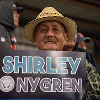 B.R. Yazzie, 78, holds a Shirley/Nygren campaign sign before the polls close for the Navajo Nation Presidential election on Tuesday in Window Rock.