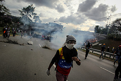 Bolivarian National Guard fires tear gas against opposition supporters on the Francisco Fajardo expressway against President Nicolas Maduro this May 1, 2017.