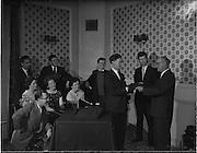 23/ 06/1961.06/23/1961.23 June 1961.Gael Linn special - Gael Linn cabaret recieves present of slacks. Gael Linn is an organization devoted to the Irish language and arts.