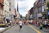Dave Madden of Something Sweet Dessert & Café speaks during the awards ceremony at the Run 4 Downtown road race in Middletown, N.Y.