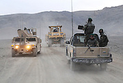 """ANA soldiers from 3rd Brigade, 201st Corps, use heavy construction equiptment to improve the road in Tagab Valley.....One of the main tactics is a new road through Tagab Valley that will allow traffic to bypass Kabul providing a more direct link between Pakistan and destinations north including Uzbekistan and Tajikistan.....To win the Tagab Valley, Colonel Haynes said, """"The creeping barrage of goodness, really centers on the road going up the valley, because then you can begin development projects and increase prosperity.  The cab fare for villagers went from $8 down to $1 just because the ANA graded the road.""""  As the ANA move north through the valley they are building combat outposts to sustain the gains.  Haynes confirmed this is an ANA campaign - the first of its kind - his soldiers are mentoring the ANA, there are no coalition troops.  .."""