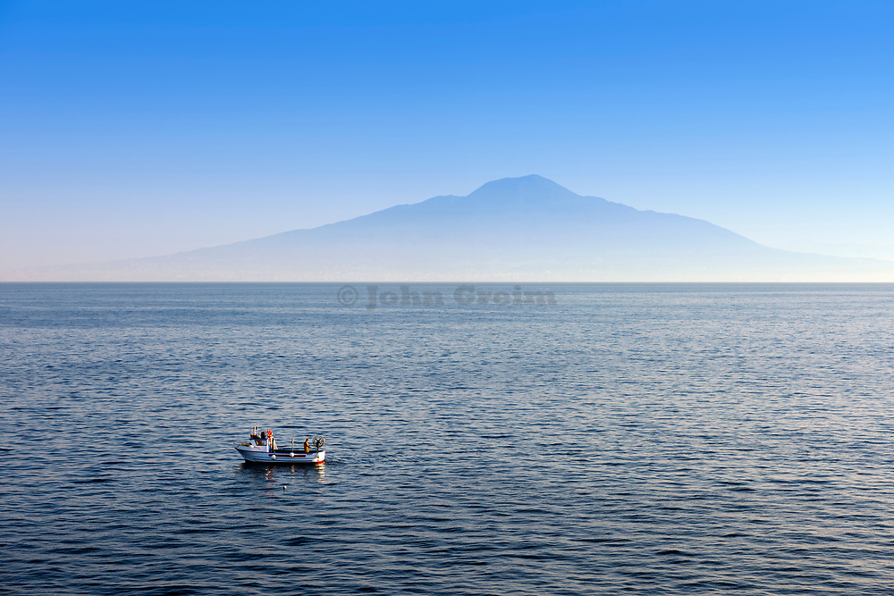 Commercial fisherman checks his traps in the shadow of Mount Vesuvius, Naples, Italy