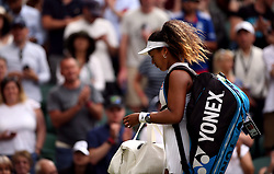 Naomi Osaka leaves court after losing to Yulia Putintseva on day one of the Wimbledon Championships at the All England Lawn Tennis and Croquet Club, Wimbledon.