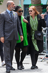 London, UK. 14 June, 2019. Emma Dent Coad, Labour MP for Kensington, leaves after laying a floral tribute at the foot of the Grenfell Tower following a memorial service at St Helen's Church to mark the second anniversary of the Grenfell Tower fire on 14th June 2017 in which 72 people died and over 70 were injured.