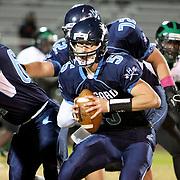 Hoggard's Austin Schoenleber looks too pass against West Brunswick Monday night at Hoggard High School. (Jason A. Frizzelle)