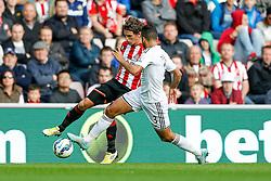 Billy Jones of Sunderland is challenged by Neil Taylor of Swansea City - Photo mandatory by-line: Rogan Thomson/JMP - 07966 386802 - 27/08/2014 - SPORT - FOOTBALL - Sunderland, England - Stadium of Light - Sunderland v Swansea City - Barclays Premier League.