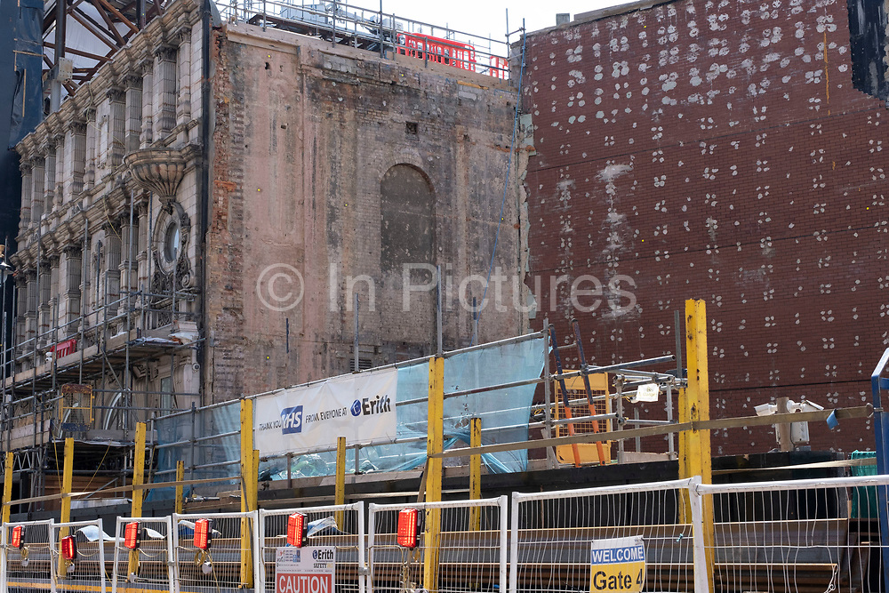 Large construction site of a whole block due for redevelopment just behind the famous electronic advertising boards at Piccadilly Circus on 26th June 2020 in London, United Kingdom. The site, which is on a massive scale, reveals the inner brickwork of the buildings exposed.