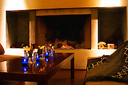 The cosy corner in front of the fire place with blue candles and sofas couches. The Dolly Irigoyen - famous chef and TV presenter - private restaurant, Buenos Aires Argentina, South America Espacio Dolli