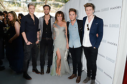 Centre, AMANDA HOLDEN poses with Andy Brown, Ryan Fletcher, Joel Peat and Adam Pitts of Lawson at the Glamour Women of the Year Awards in association with Pandora held in Berkeley Square Gardens, London on 4th June 2013.