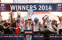 Peterborough Captain Tommy Rowe (ENG) lifts the trophy as his side celebrate their 3-1 win - Photo mandatory by-line: Rogan Thomson/JMP - 07966 386802 - 30/03/2014 - SPORT - FOOTBALL - Wembley Stadium, London - Chesterfield FC v Peterborough United - Johnstone's Paint Trophy Final.