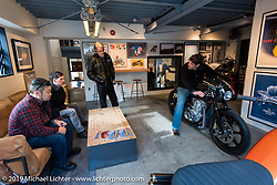 Harley-Davidson's (L>R) Dais Nagao, Ben McGinley, head of design Ray Drea and Charlie Wartgow at the Deus Ex Machina new Tokyo store 3-days after its grand opening. Tokyo. Japan. Wednesday, December 10, 2014. Photograph ©2014 Michael Lichter.