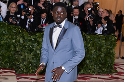 Daniel Kaluuya walking the red carpet at The Metropolitan Museum of Art Costume Institute Benefit celebrating the opening of Heavenly Bodies : Fashion and the Catholic Imagination held at The Metropolitan Museum of Art  in New York, NY, on May 7, 2018. (Photo by Anthony Behar/Sipa USA)