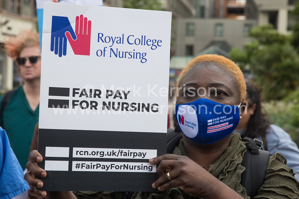 A NHS nurse prepares to march from St Thomas' Hospital to Downing Street to protest against the NHS Pay Review Body's recommendation of a 3% pay rise for NHS staff in England on 30th July 2021 in London, United Kingdom. The protest march was supported by Unite the union, which has called on incoming NHS England Chief Executive Amanda Pritchard to ensure that a NHS pay rise comes from new Treasury funds rather than existing NHS budgets and which is shortly expected to put a consultative ballot for industrial action to its members.