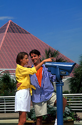 Man and woman standing at a periscope at Moody Gardens in Galveston Texas