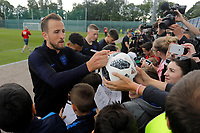 SAINT PETERSBURG, RUSSIA - JUNE 13: Harry Kane (L) of England national team signs autograph after an England national team training session ahead of the FIFA World Cup 2018 in Russia at Stadium Spartak Zelenogorsk on June 13, 2018 in Saint Petersburg, Russia.