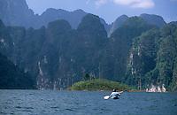 A kayaker paddles through Khao Sok National Park, Thailand.