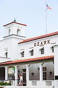 HOT SPRINGS, AR – JUNE 28, 2013: Pedestrians walk into the Ozark building on historic Bathhouse Row.