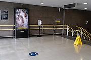 A government NHS National Heath Service advert displaying the face of a Covid patient, is at the top of steps at a deserted Blackfriars rail station during the third lockdown of the Coronavirus pandemic, in the City of London, the capitals financial district, aka The Square Mile, on 2nd February 2021, in London, England.