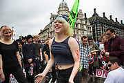 London, UK. Saturday 20th June 2015. People's Assembly against austerity demonstration through Central London. 250,000 people gathered to protest in a march through the capital protesting against the Tory cuts, holding placards and banners. Group of young women dancing in Parliament Square.