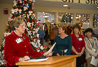 Sue Dalton reads the names of lost loved ones honored during the Celebration Reading at the Lakes Region General Hospital Auxilliary Tree of Love Services held Thursday afternoon.  (Karen Bobotas/for the Laconia Daily Sun)